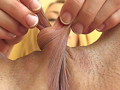 Blonde cutie stretches her long pussy lips and play with her clit untill she reaches high orgasm