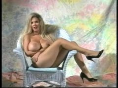 Retro porn with a huge fake tits girl solo