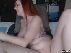 Redhead with nice tits plays with her ass