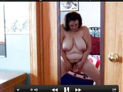 BBW uses dildo while standing