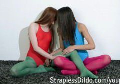 Girls in leotards and pantyhose having strapon fun after aerobics