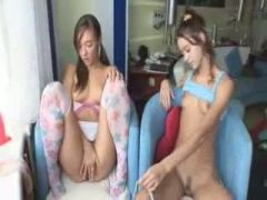 Two cuties strip on the sofa