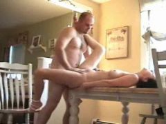 Fucking his girl on the dining room table