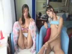 Two cuties masturbating on the bedstead