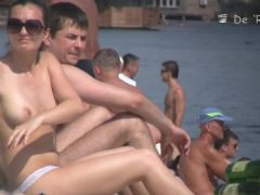 Beach is full of nudist men and women with good bodies
