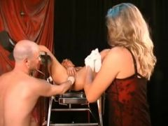 First she\'s fisted, then her labia gets pierced!
